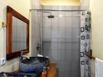 Family bathroom. Rain shower, Stone basin, and W/C.