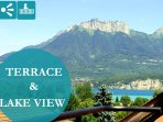 Terrasse avec vue lac et montagnes