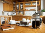 Beechnut dining table. Essentials like coffee supplied with complimentary cake on arrival.