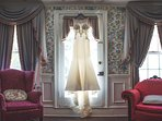 Dress hanging in the sunlight in the blue room!