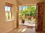 Stroll through the french doors to sit on the patio and enjoy views of rolling Tipperary countryside