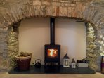 Relax in front of the flickering flames of the woodburning stove, set into the period fireplace.