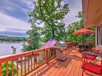 Relax on the back deck of this 5-bedroom, 3-bathroom lakefront home in Camdenton.