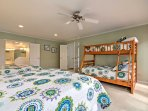 Head down the hall to the master bedroom which has 2 queen beds and a twin-over-full bunk bed.