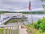 Walk down a flight of stairs to get to the lake and private dock.