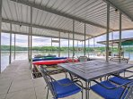 In addition to slips for boats and jet skis, the private dock has seating and table.