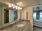 This bathroom offers a spacious vanity, overhead lighting and a walk-in shower.