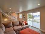 Climb the carpeted staircase to the second-floor family room, where guests can spread out on the spacious sectional and...