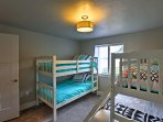 This bedroom offers a twin bunk beds, as well as a twin-over-full bunk bed.
