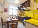 Cozy kitchen with yellow tiles. Makes you feel like it's summer even in winter.