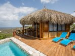 Overlooking the Caribbean Ocean from your private pool or porch from your palapa house.