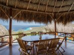 Breathtaking views from the shady porch of your big main palapa house.