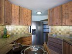 Kitchen with stove, oven, freezer/cool combination.