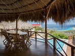 Dining area porch main palapa overlooking the Caribbean Ocean.