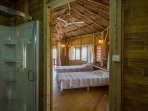 Double masterbedroom in the main palapa with ceiling fan and a private bathroom.