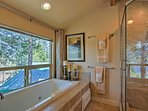 The large soaking tub is perfectly situated with lake views.