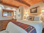 This bedroom offers a comfy queen-sized bed.