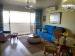 Living/dining room with balcony overlooking the beach