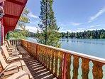 Cozy lakefront log cabin w/ lake views, a wood stove, vintage decor, & dock.