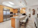 kitchen and granite breakfast bar