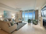 living room with floor to ceiling sliders to balcony