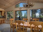 Wooden dining table with a Tahoe chandelier