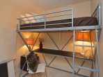 Loft bed with a desk
