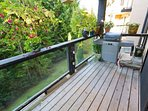 Deck looking to forest with gas BBQ.