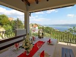 Covered outdoor dining area with sea views