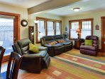 Upon entering this home, you're greeted by the living room with original hardwood floors and wall-to-wall wooden...