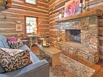 Through the front door of this completely remodeled wooden cabin, you are surrounded by elegant cottage decor and rich...