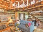 A vaulted ceiling with wooden, arching beams opens the home, with every inch meticulously, expertly designed to...