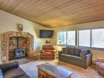 The living room has a gas fireplace and a flat-screen cable TV.