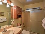Sliding glass doors frame this shower/tub combo.