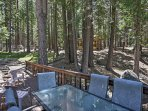 Enjoy meals out on the patio with lush forest views.
