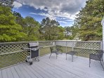 The home is nestled on a quiet, green property and features a spacious deck to enjoy it all!