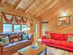 Relish the wood accents, comfy furniture, and mountain decor!