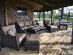 Outdoor furniture on every side of this octagon home giving you  a clear view of Little Crooked Lake
