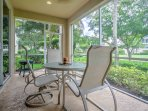 Enjoy a refreshing beverage outside on the back patio that overlooks a lush golf course.