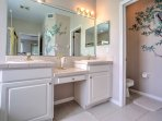 Dual sinks and a large vanity make it easy for multiple people to freshen up at once.
