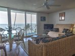 Renovated beach-wood floors sprawl through the condos open-concept layout.
