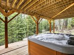 Soak your sore muscles in the 6-person hot tub while listening to the babbling brook that runs through the property.