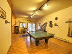 The ping pong table in the basement can be converted into a pool table!