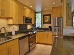 Gourmet kitchen with granite counter tops and new stainless steel appliances
