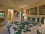 Luxury master bedroom suite with California king bed, LCD TV, and DVD player