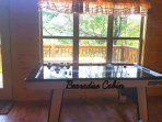 Game room with air hockey, fooseball, pool table, board games