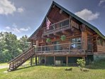 You'll love this Williamstown vacation rental cabin's stunningly crafted log exterior!