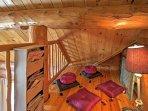 The master bedroom has its own quaint loft area.