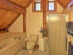 Unwind with a relaxing soak in the spa-like master bathroom's bathtub.