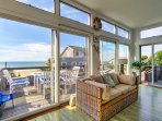 The large glass windows in the living room provide guests with amazing ocean and beach views.